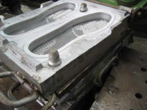 Outsole mold with locater pins