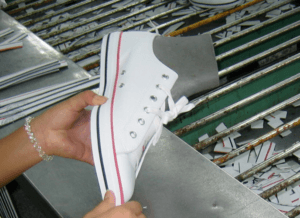 Shoe lasting In a shoe factory