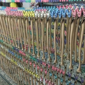 purse straps in a handbag factory